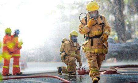 Firemen in gear with hoses